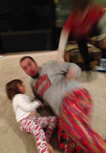 As I wrestling with my daughter, Cam did his best cannon ball. I love the look on my face. I know what's coming.