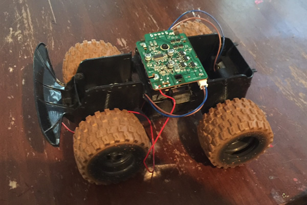 This is a remote-controlled truck that Camden took apart. He planned to take apart several of these and put them all together into one big truck.